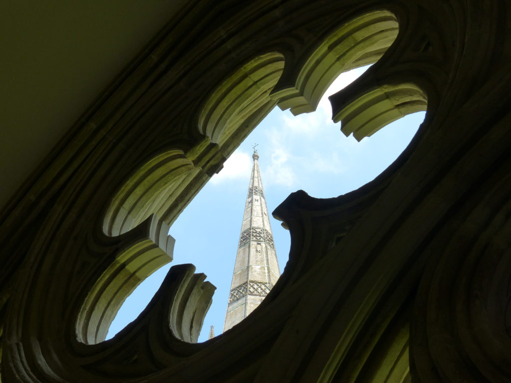 The spire framed by a window inside the cathedral
