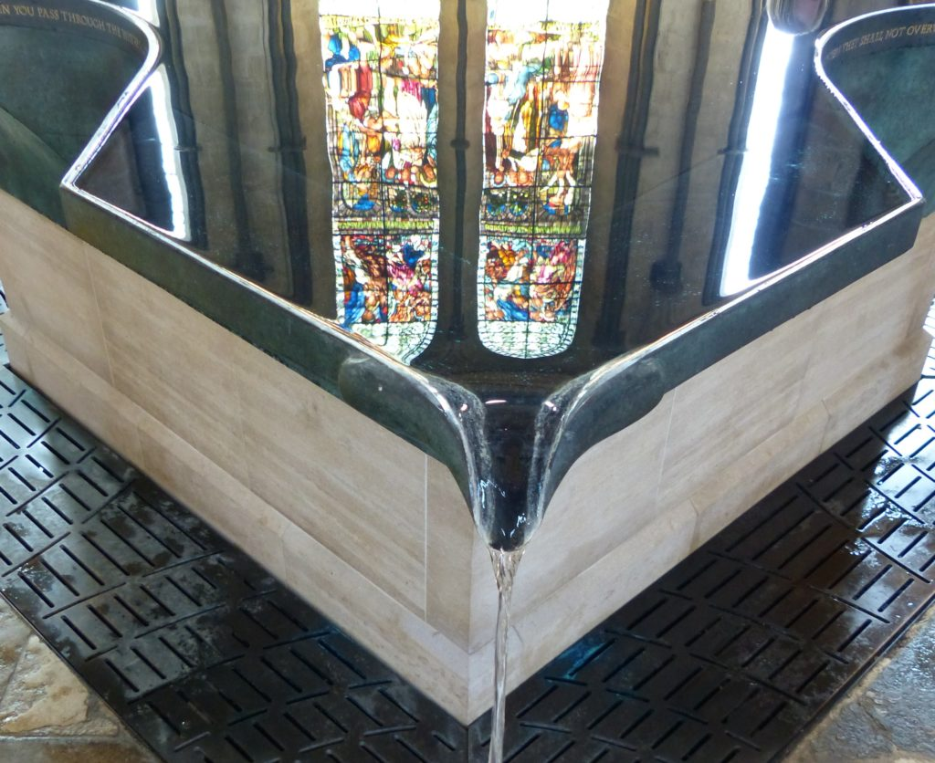 Water dripping from pool into nave
