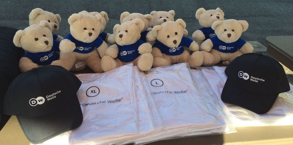 Deutsche Welle teddy bears and hats.